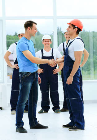 commercial construction: Customer Shaking Hands With Builder Stock Photo