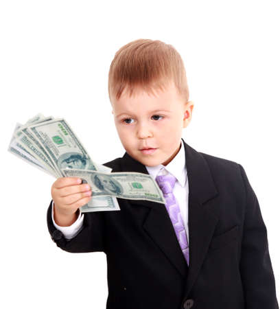 carves: Portrait of a cheerful little boy holding a dollars over white background