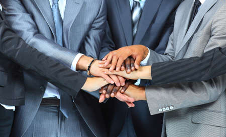 young office workers: Team work concept. Business people joining hands.
