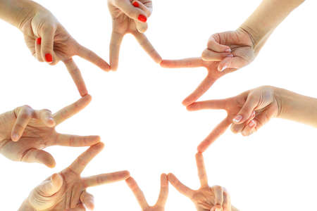 manos juntas: United hands isolated on white Conceptual photo of teamwork Foto de archivo