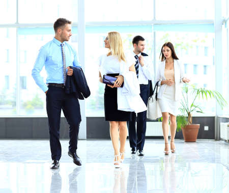 co work: businesspeople group walking at modern bright office interior Stock Photo