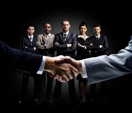 Handshake isoliert auf betriebswirtschaftlichen Hintergrund Lizenzfreie Bilder