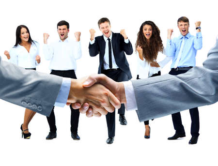 happy business team: handshake on a background of a happy group of people