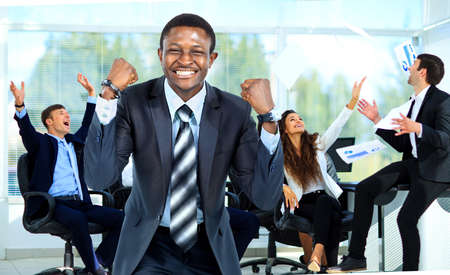 arms up: Business team celebrating a triumph with arms up Stock Photo