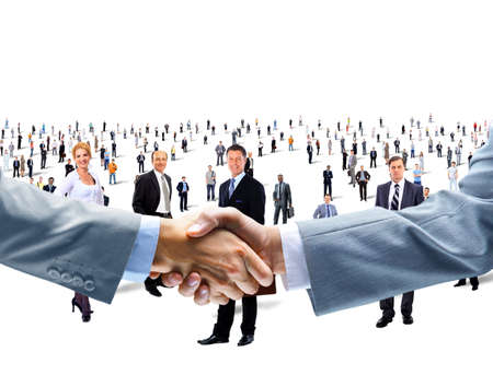 workgroup: shaking hands on a background of a large group of people