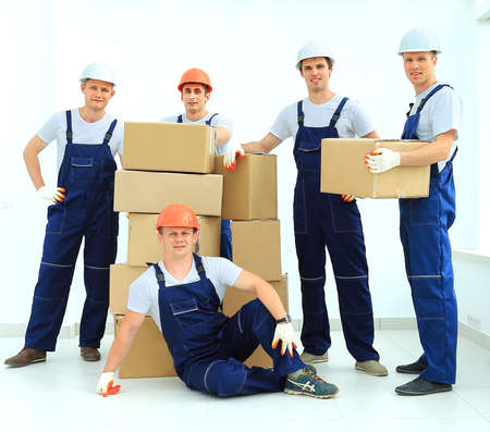 on the move: workers unload boxes Stock Photo