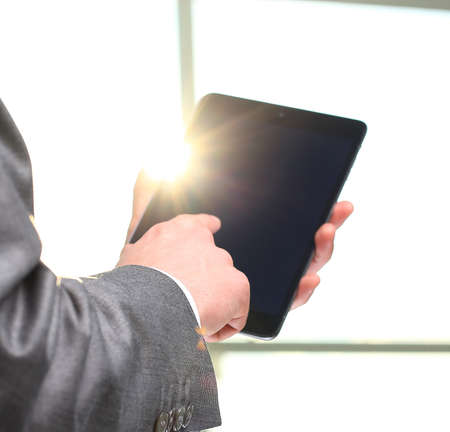 touch: man holding digital tablet, closeup