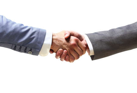 promising: handshake of business partners after signing promising contract
