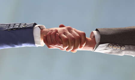 business partners: handshake of business partners. bottom view
