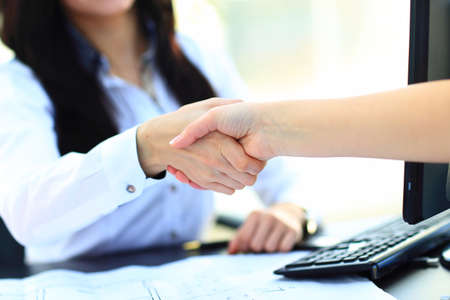 two hands: Close Up Of Two Women Shaking Hands, Indoors