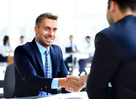 altogether: businessman shaking hands to seal a deal with his partner