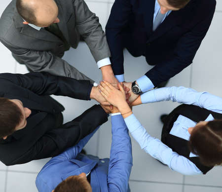 joining hands: Business people joining hands in circle