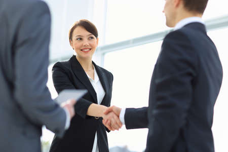 Two professional business people shaking hands photo
