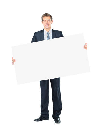 Happy smiling young business man showing blank signboard photo