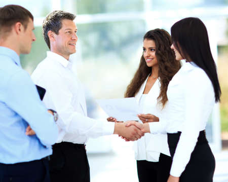 businessman shaking hands to seal a deal with his partner photo