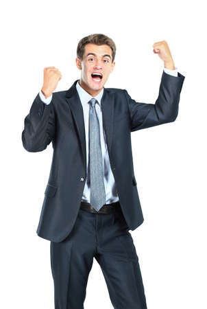 Business man throwing fists in air and smiling photo