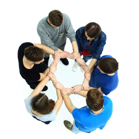 circulo de personas: Top view of young people with their hands together in a circle. Foto de archivo