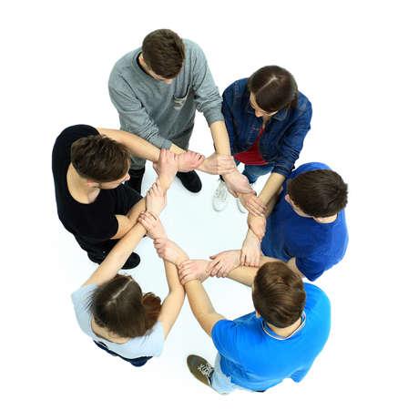 circulo de personas: Vista superior de los jóvenes con sus manos juntas en un círculo.