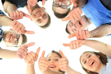 circulo de personas: friendship, youth and people concept - group of smiling teenagers with hands on top of each other