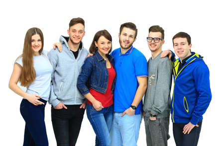 standing together: group of smiling friends staying together and looking at camera isolated on white background