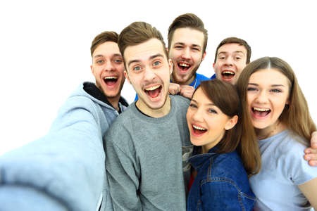 白い背景に分離された selfie 写真を撮る幸せな若い 10 代学生のグループ 写真素材