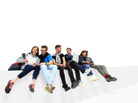 causal: Causal group of people sitting on the floor isolated