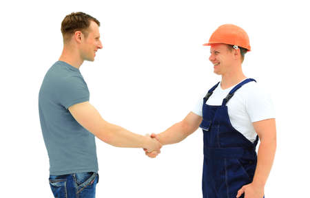 construction workers: Customer Shaking Hands With Builder isolated on white