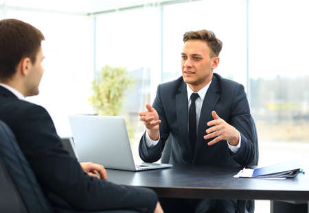 men talking: Happy business people talking on meeting at office