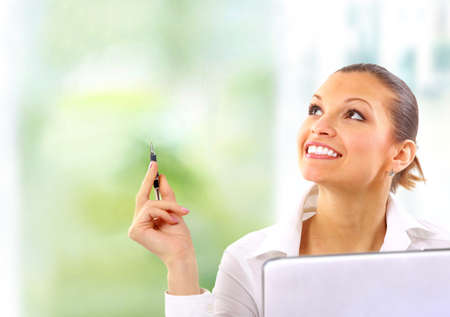 modern businesswoman: Happy cute brunette looking away with a smile Stock Photo