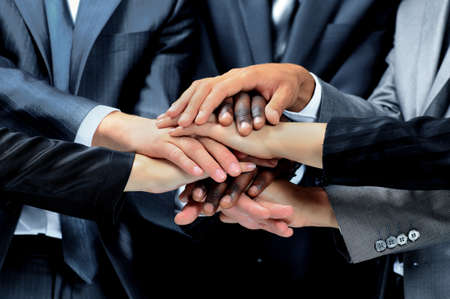 workgroup: diverse group of workers with their hands together in form of teamwork Stock Photo
