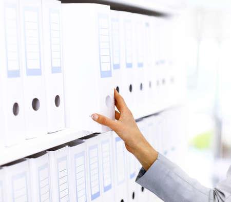 categorize: Shelf with Folders for documents