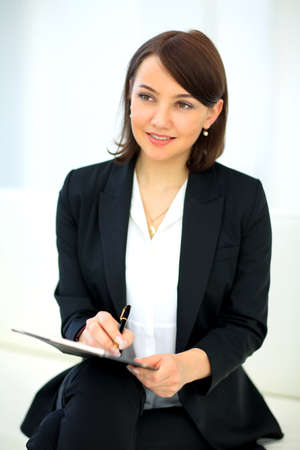 sexy teacher: Portrait of happy smiling business woman with black folder