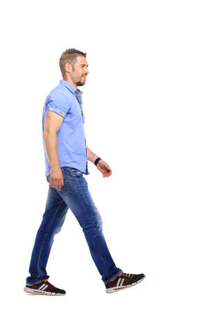 informal clothes: Full portrait of smiling walking man in blue shirt casuals isolated on white background. Stock Photo