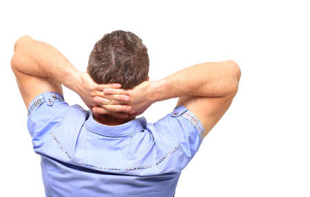 hands on head: Casual man with hands behind his head from back