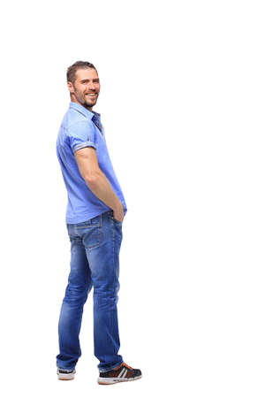 looking over shoulder: man in a full-length white background turns from a shoulder Stock Photo