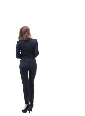 back view: Business woman stand back side with white wall background