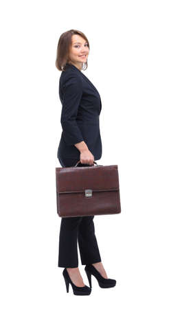 business traveller: Profile of  businesswoman with suitcase looking at camera, isolated on white.