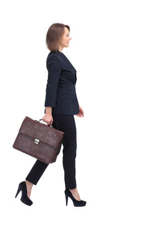 executive woman: Profile of walking businesswoman, isolated on white. Stock Photo
