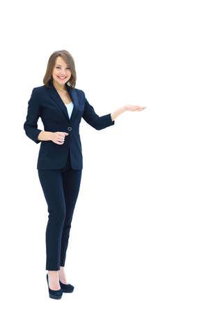 白で隔離ヤシを示す幸せな若い美しいビジネス女性