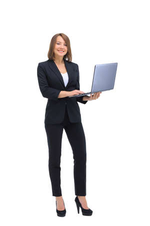 woman business suit: Beautiful young business woman in suit keeps laptop in hand, smiling, looking at camera, on a white background Stock Photo