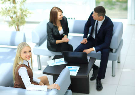 young businessman: Image of business partners discussing documents and ideas at meeting