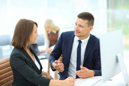 collegue: Young businessman explaining somethind to his collegue