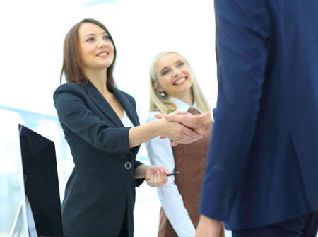tech support: Close-up part of young beautiful women shaking hands with smile Stock Photo