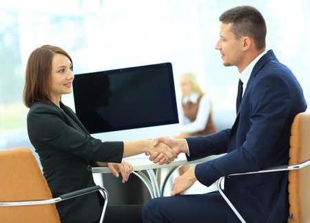 handshaking: Cheerful businesspeople handshaking. finish job