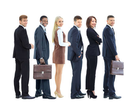 Happy smiling young business people staying. Side view. Stock Photo