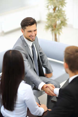two hands: Business people shaking hands over a deal