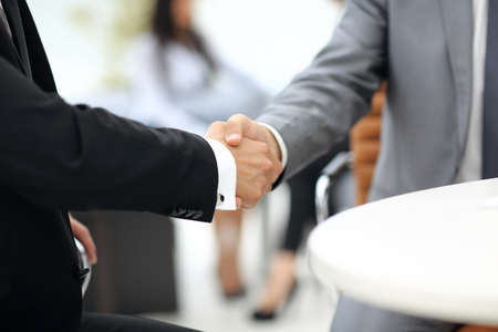 handshaking: Business people shaking hands during a meeting