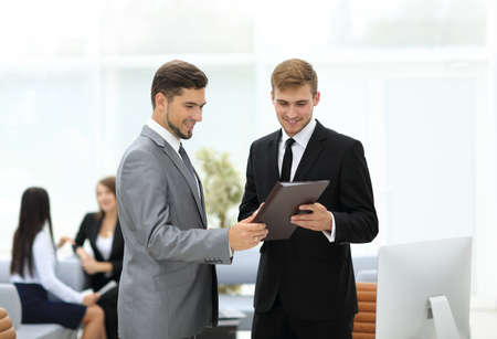 congratulating: Business team discussing together business plans Stock Photo