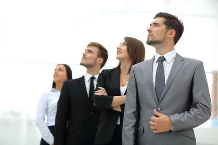 Corporations: Smiling employees in a line at work