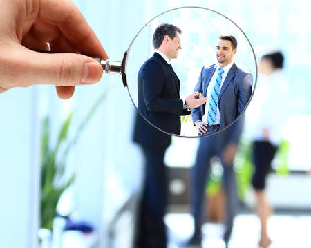 Magnifying glass and businessman in focus